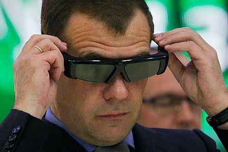 Russian President Dmitry Medvedev looks through 3D glasses